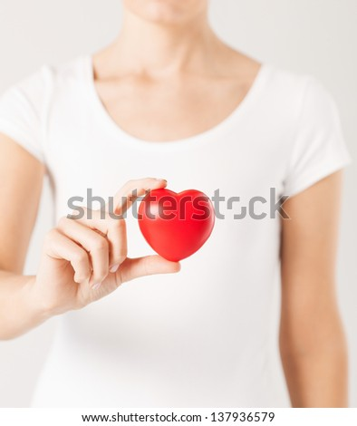 close up of woman hands with heart