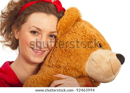 Close up of woman hugging  big teddy bear isolated on white background - stock photo