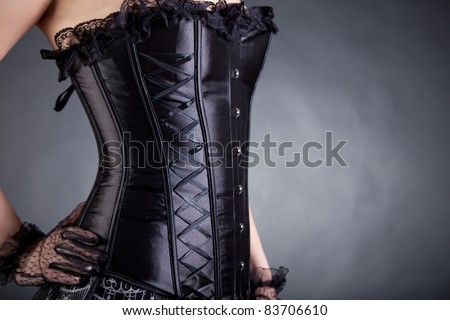 Close-up of woman in black corset, copy-space for your text - stock photo