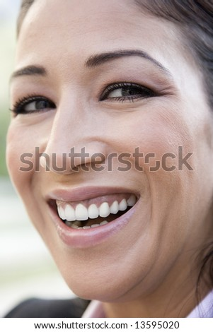 Close-up of woman laughing at camera