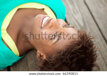 Close up of woman laying down - stock photo