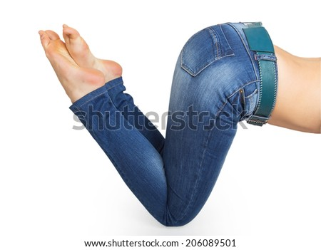 Close up of woman legs with jeans and barefoot isolated on a white background - stock photo