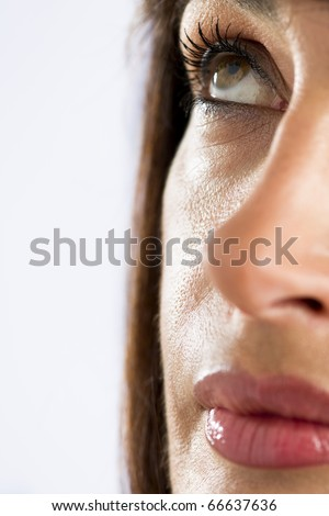 Close-up Of Woman Looking Up - stock photo