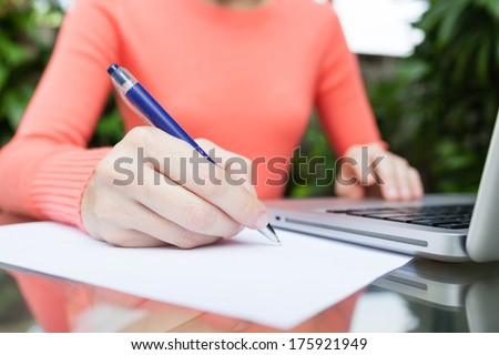 Close up of woman making notes. Woman studying, - stock photo
