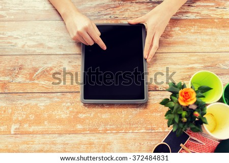 close up of woman or gardener with tablet pc - stock photo