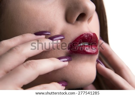 Close-up Of Woman's Face With Red Lipstick And Shiny Nail Varnish - stock photo