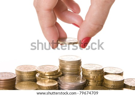 Close-up of woman?s fingers picking a coin - stock photo