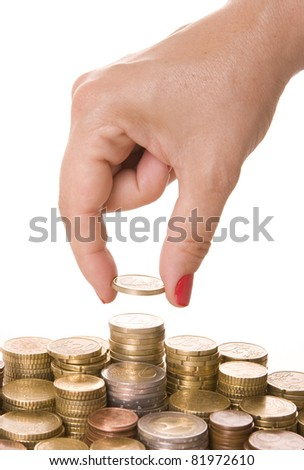 Close-up of woman?s fingers picking a coin