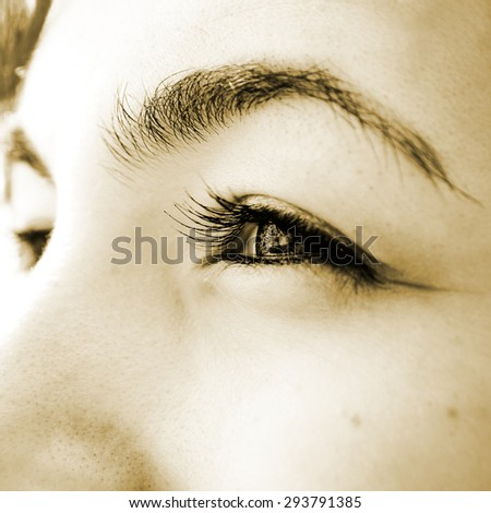 Close-up of  woman's green eyes. - stock photo