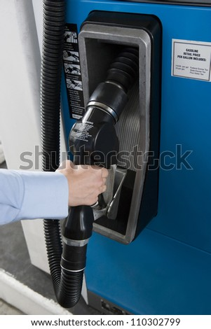 Close-up of woman's hand holding gasoline
