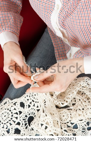 Close-up of woman's hand knitting - stock photo