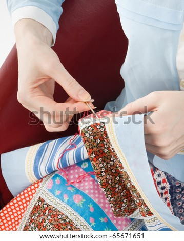 Close-up of woman's hand stitching quilting - stock photo