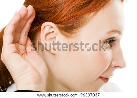 Close up of woman's hand to his ear on a white background. - stock photo