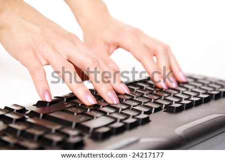 Close-up of woman?s hand touching computer keys during work