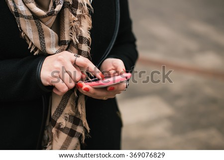 Close-up Of Woman's Hand Using Cell Phone - stock photo