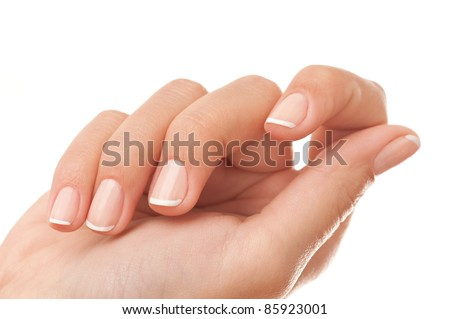 Close-up of woman?s hand with French manicure isolated on white. - stock photo
