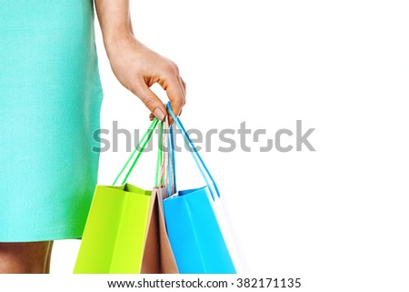 Close up of woman`s hand with shopping bags isolated on white background. Shopping concept. - stock photo