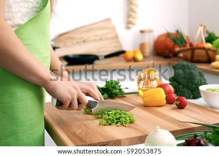 Woman Cutting Bread On Kitchen Stock Photo 73187602