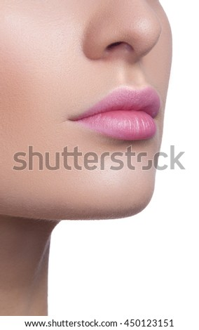 Close-up of woman's lips with bright fashion pink glossy makeup. Macro magenta lipgloss make-up. Highly saturated color. - stock photo