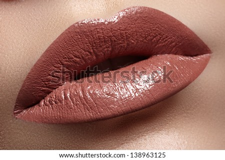 Close-up of woman's lips with fashion natural white coffee lipstick makeup. Horizontal macro sexy pale lipgloss make-up - stock photo