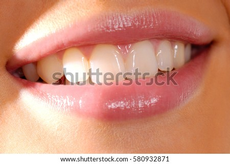 Close up of woman's smiling mouth and nice teeth
