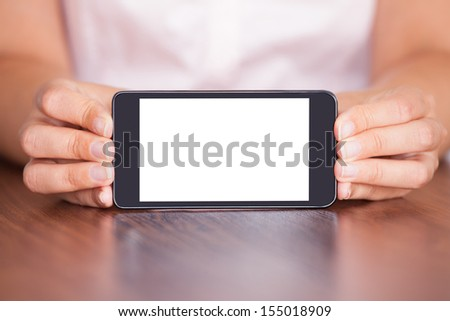 Close-up Of Woman Showing Mobile Phone With Blank Screen - stock photo