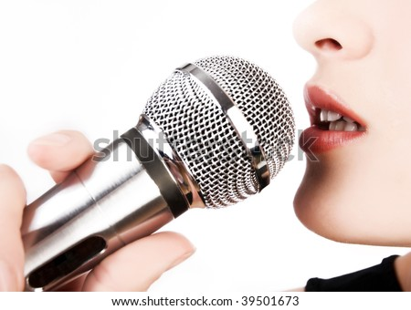 Close up of woman singing into microphone - stock photo