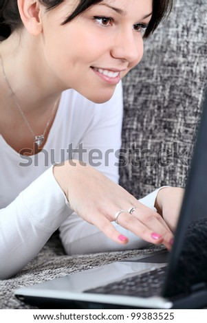 Close up of woman surfing or working on laptop - stock photo