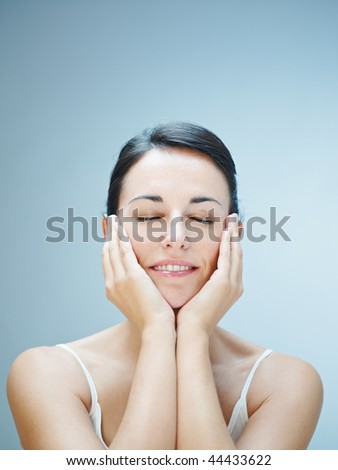 close up of woman touching chins. Copy space - stock photo