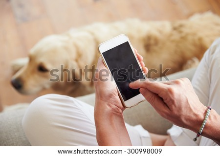 Close Up Of Woman Using Smartphone At Home - stock photo