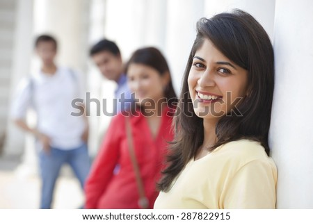 Close-up of woman with friends in the background - stock photo