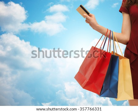 close up of woman with shopping bags and bank card - stock photo