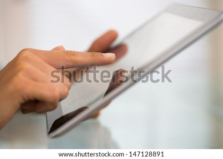 Close-up of woman working with digital tablet pc - stock photo