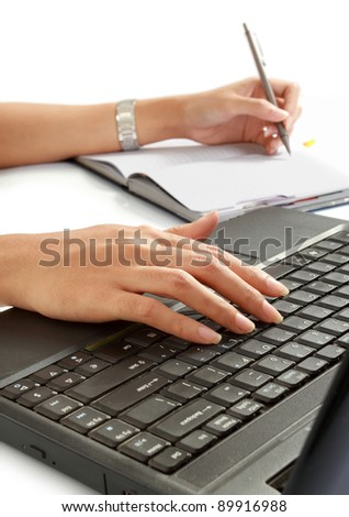 close up of woman write a book and typing her laptop. isolated over white - stock photo