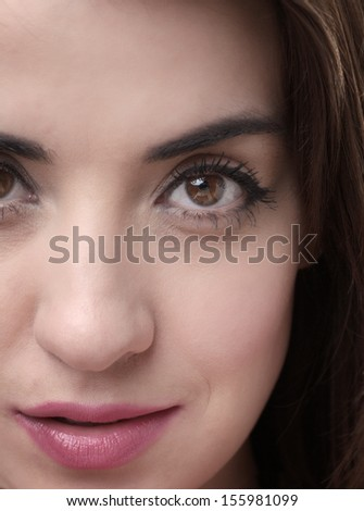 close up of womans face shot in the studio - stock photo