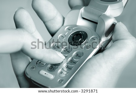 Close up of women hand using a opened cell phone. - stock photo