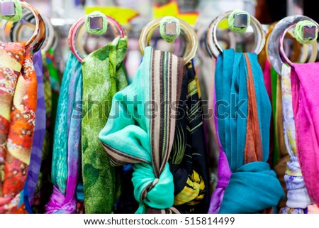 Close up of women's scarves hanging in a store
