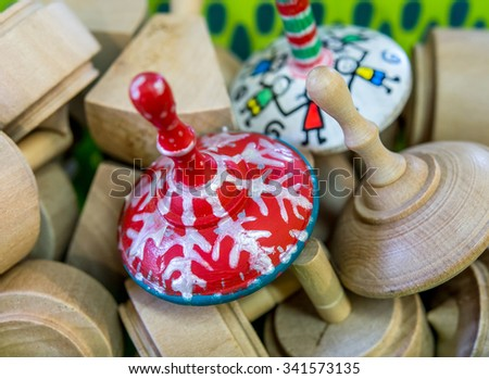 Close up of  wood  Hanukkah dreidels on market  DISPLAY. - stock photo