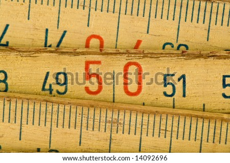 close up of wood meter tool - stock photo