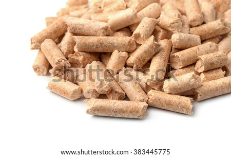Close up of wood pellets on white background - stock photo