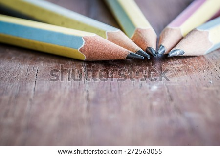 Close up of Wood Pencil on Wood Table Desk, soft focus - stock photo