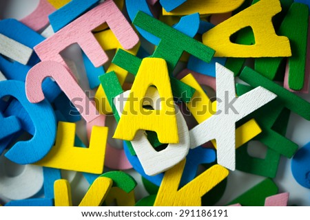 Close up of wooden alphabets forming background