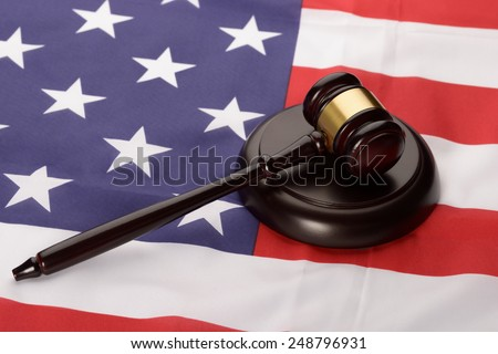 Close-up Of Wooden Brown Gavel Over Usa Flag - stock photo