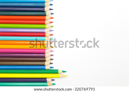 Close up of wooden multiple colour pencils on white background - stock photo