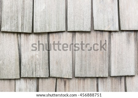 Close up of wooden shingles rustic background wall