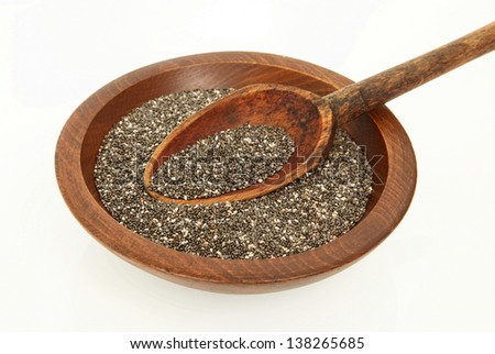 Close Up of Wooden Spoon In Bowl Of Chia Seeds - stock photo