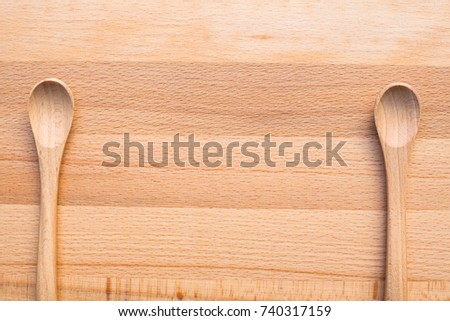 close up of wooden spoon on wooden background