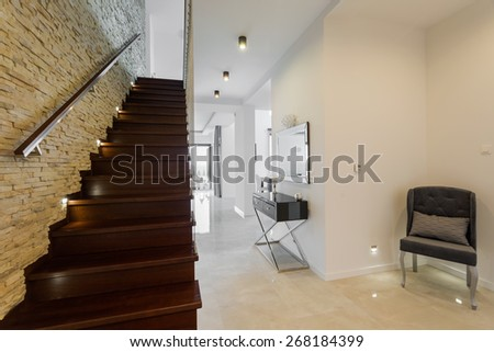 Close-up of wooden stairs in designed modern interior - stock photo