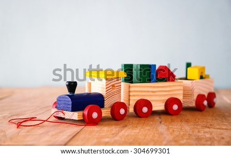 close up of Wooden toy train over wooden table. selective focus  - stock photo