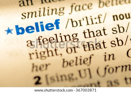 Close-up of word in English dictionary. Belief, definition and transcription - stock photo